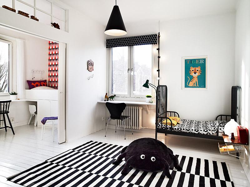une chambre denfant en noir et blanc
