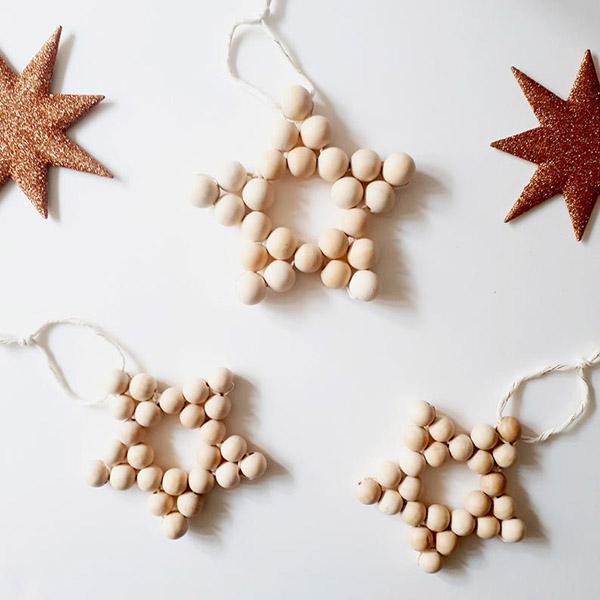 Etoile de Noël en perle de bois - Honorine et Jean sur Etsy