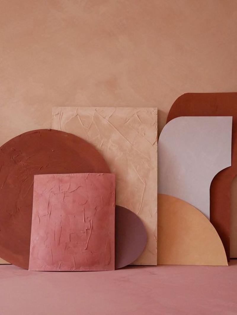 Palette de couleurs terracotta, rose, beige et brun